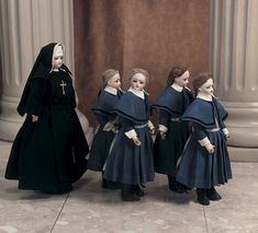 """13"""" nun,11"""" girls. Each has bisque swivel head on bisque shoulderplate,blue glass enamel inset eyes,painted lashes and brows,accented nostrils,closed mouth with accented lips,kid poupee body with shapely torso,stitched and separated fingers. . Marks: 2/0 (girls) 0 (nun). Comments: Gaultier,circa 1880. Wonderful presentation of nun in original well-detailed costume,along with four students wearing blue woolen school uniforms,each with long mohair braids."""