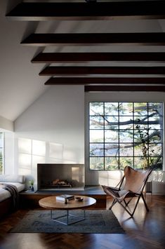 Cosy fireplace nook and beamed ceiling.