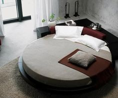 """Though much of the round bed design relies on the shape of the room, this """"Plato"""" round bed offers a great corner piece that integrates seamlessly with the wall space."""