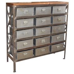 Add unique, individual style to your home with this Porter Vintage Storage Cabinet. Made of metal and wood, this chest has a silver coloring that will work with any home style. This large vintage inspired industrial cabinet features 15 sliding metal drawers that slide in and out easily, perfect for storing and organizing your crafts and collections.