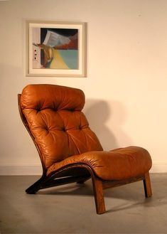 Oddvin Rykken; Rosewood and Leather Lounge Chair for Rybo, 1960s.