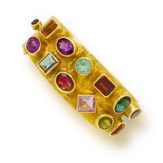 A gem-set and eighteen karat gold bangle bracelet, Ed Wiener