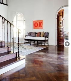 """The couple loves collecting pop art. The """"OK"""" artwork by Ed Ruscha, which happens to be Shereen's husband's initials, hangs in the front foyer for impact."""