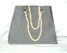 Fabric Tote - Can be used as a handbag, beach bag or shopping bag. Black with white stripes, black lining, rope handles. Approximately x x gusset. Fabric Handbags, White Handbag, Beach Tote Bags, Black Handbags, Drawstring Backpack, Shopping Bag, Stripes, Fashion, Fabric Purses