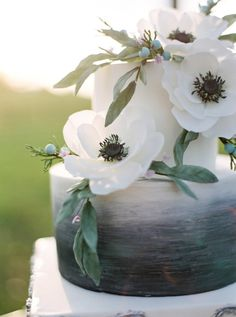 Floral Wedding Cakes The charcoal centers of the sugar anemones on this Fluffy Thoughts Cake confection tied the florals back to its ink-to-gray base. - These confections make the case for unique, colorful desserts. Wedding Cake Fresh Flowers, Small Wedding Cakes, Floral Wedding Cakes, Amazing Wedding Cakes, Wedding Cake Designs, Wedding Colors, Charcoal Wedding, Mod Wedding, Fall Wedding