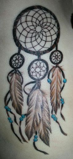 Dreamcatcher Tattoos For Women | miley has a large dreamcatcher tattooed on her right side a friend ...