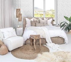 Our 100% linen slip cover Zulu Upholstered Bed, Sodwana Stool, Primitive Pendant Lights and Sheeprug all come together to create this unique bedroom space.
