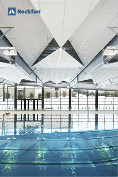 """Some of the most difficult spaces in which to control acoustics are indoor swimming pools, which are notorious for the reverberating sounds of excited voices and splashing. Achieve #sound absorption with durable materials. """"We created #triangular-shaped #islands – like #origami, because they grab sounds in the angles and help stop echoes. Using #Rockfon, we were also sure to achieve high humidity resistance and durability – which were key priorities for me, as an architect."""" #SoundsBeautiful Soundproof Panels, Acoustic Design, Le Cap, Pool Picture, Indoor Swimming Pools, Modern Ceiling, Acoustic Panels, Sound Proofing, Visual Comfort"""