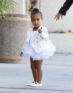 north west kardashian 2015 tutu | Designer ballerina: The toddler was dressed in a white tutu and custom ...