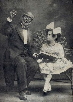 """""""Uncle Tom and Little Eva, in Stetson's Uncle Tom's Cabin."""" Photo card, ca. 1890s."""