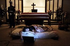 "i will cry everytime i see this....The night before the burial of her husband, Katherine Cathey refused to leave the casket, asking to sleep next to him for the last time. The Marines made a bed for her, tucking in the sheets below the flag. Before she fell asleep, she opened her laptop computer and played songs that would have been played at a formal wedding they never held. She asked the Marines to continue standing watch. ""I think that's what he would have wanted,"" she said."