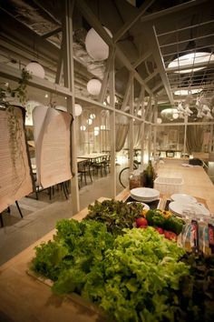 Metaphor Design Studiohave drawn inspiration from the artist's studio for this Bangkok restaurant, House of Salad.
