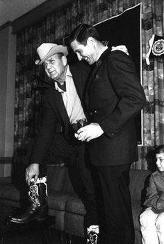 """Bear"" shows off his boots: University of Alabama football coach Paul ""Bear"" Bryant, left, poses with Texas A coach Gene Stallings in Dallas on Dec. 30, 1967. The two teams met in the Cotton Bowl on New Year's Day. Stallings, who later coached Alabama, played for Bryant at Texas A and was also an assistant under Bryant at Alabama from 1958-1964."