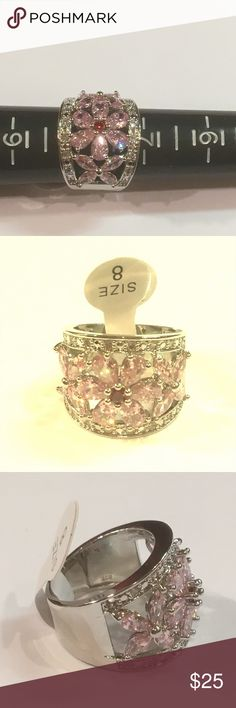 Stunning NWT Pink, White, Red Topaz 925 Ring New with tag very sparkly and beautiful pink and red topaz flower ring outlined with white topaz stones.  925 stamped silver size 8. Jewelry Rings