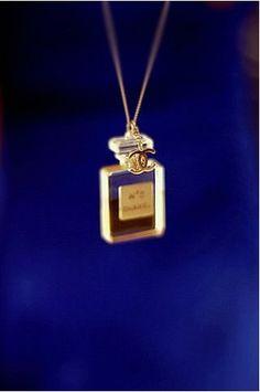 Tiny Chanel no. 5 perfume necklace.