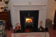 #Chesneys #Salisbury5 #woodburner #stove within the #Devonshire #limestone surround