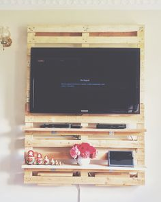 My dad and I made this TV wall mount out of Pallets. I love it and it gives the room so much space. #Pallets #TVMount