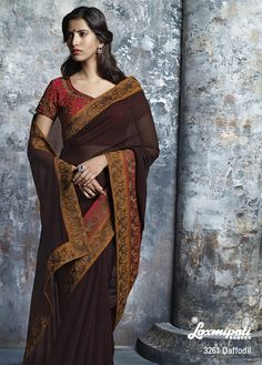 This plain brown georgette saree with adorable heavy work border patti & contrast red blouse are truly a Leader. A simple, with unique twist!