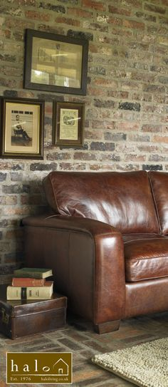 leather sofa - dark gray walls w red chest / books - basement