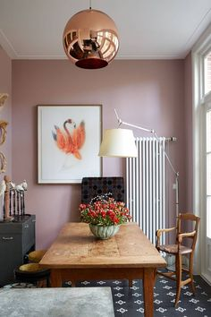 Ideas for small dining rooms - from furniture - tables, seating and suites to cabinets and dressers to paint and decoration - on HOUSE - including this pink dining room with a farmhouse table. Pink Dining Rooms, Dining Room Paint, Dining Room Colors, Dining Room Lighting, Dining Room Design, Copper Dining Room, Dining Room Colour Schemes, Kitchen Dining, Living Rooms