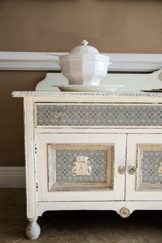 Painted buffet with decorative paper inserts