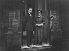December 1921: Arthur Griffith (1872 - 1922), Irish journalist and nationalist leader, who negotiated the treaty partitioning Ireland and founded Sinn Fein, with his wife on the doorstep at 22 Hans Place in London.