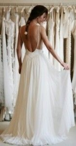 Such pretty straps on this backless wedding dress!