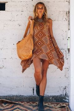 Release your inner bohemian beauty with this warm earth toned geometric pattern. The Mexicana dress features adjustable shoe string straps and a drapey silhouette.