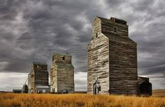 12 x 18 glossy photo of old grain elevators shot at Rapelje, Montana copyright James J Larson. Image has slight painterly effects. Old Buildings, Abandoned Buildings, Abandoned Places, Unique Buildings, Grain Silo, Big Sky Country, Country Barns, Country Life, Country Roads