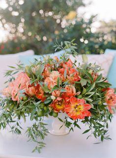 Bright orange bi-colored tulips: http://www.stylemepretty.com/2016/02/26/elegant-seaside-wedding-with-a-pop-of-orange/   Photography: Joel Serrato - http://joelserrato.com/