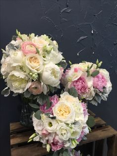 Lovely Bridal bouquet with ranunculus, O'hara roses, peonies, lisianthus, eucalyptus and silver leaves. Bridesmaid bouquet with Sweet Avalanche roses, peonies, lisianthus, eucalyptus and silver leaves.