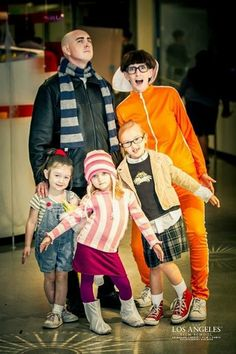 Despicable Me family costume. After 2nd movie came out, mom could be the new wife of Gru and my boys could be minions! YES