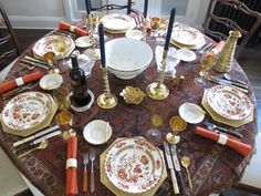 Eddie Ross - Amazing Table Setter.  Love this for Thanksgiving.  He used a vintage rug for the table cloth.