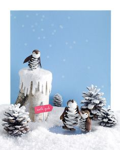 Pinecone penguins.This family of painted pinecone birds colonizes a magical snowscape decorated with glitter, bits of flocking, and a mirror pond.    what a cute idea!!!