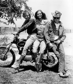 Vintage photo of Lauren Hutton on a bike with Robert Redford // credit: Paramount/Getty Images
