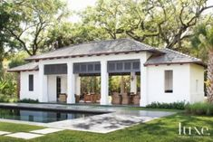 A #Neoclassical style Miami retreat's contemporary #poolside cabana #exterior | See MORE at www.luxesource.com | #luxemag | #interiordesign #design #exteriors