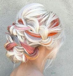 Awesome pop of color that stands out in her blonde hair. This is such a beautiful idea for an updo for a wedding!