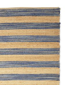 Bold stripes in a mélange of blues give this rug a coastal vibe we could easily imagine in any room. A great way to blend the natural with the bright, the tightly woven design keeps appearances fresh. Handwoven for truly original beauty.
