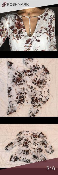Floral flowy shirt Cute floral peplum shirt with cut out in front crisscross never worn Full Tilt Tops Blouses