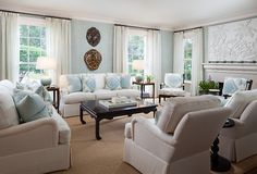 McCann Design Group features Island Raffia 3492-B Maldive Blue in the living room of a client's home.