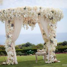 Love the abundance of white florals with beautifully draped fabric.
