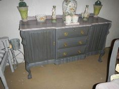 Graphite and French linen mix, sealed with dark wax.  Top has been sanded and washed with Old White.  Annie Sloan