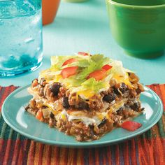 Enchilada Casser-Ole! Recipe -My husband loves this casserole…but it never lasts too long! Packed with black beans, cheese, tomatoes and Southwest flavor, it's an impressive-looking entree that's as simple as it is simply delicious! —Marsha Wills, Homosassa, Florida