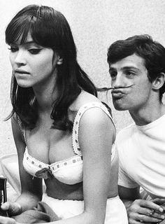 Anna Karina & Jean-Paul Belmondo on the set of 'Une Femme est Une Femme' photographed by Raymond Cauchetier, 1961.