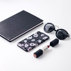 BURGA | flatlay | inspiration | flatlay inspiration | flatlay design | white flatlay | phone case | black and floral phone case |