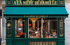 A La Mère de Famille - A new A La Mère de Famille candy shop has just opened in at 70 Rue Bonaparte, Paris, France VI. The original store on the Rue du Faubourg Montmartre, was founded in over 250 years ago! Coffee Shop Design, Cafe Design, Store Design, Boutiques, Rue Bonaparte, Café Bar, French Cafe, Cafe Shop, Shop Fronts