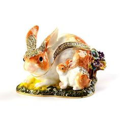 """#Bunny Family Trinket Box Item No. KB00525A01 $45.49 This beautiful bunny rabbit family trinket box is the perfect gift for Easter, and a wonderful display piece to keep all year round! Made from pewter, this trinket has been hand painted with a thick enamel and then decorated with shiny crystals. Inside there is quite a bit of room for jewelry or other small knick-nacks."""" #easter Golden Frog, Glass Figurines, Jewel Box, Little Boxes, Horse Head, Keepsake Boxes, Bunny Rabbit, Trinket Boxes, Small Gifts"""