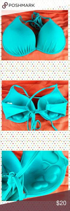 Body glove Push Up Bikini Top blue size large Gently used  BODY GLOVE  Solid Blue push up bikini top  With under wire and criss cross Adjustable tie back Adorable Heart shaped detailed Padding for extra support and push up.  Size large Fits large B cup- smaller D cup. Body Glove Swim Bikinis
