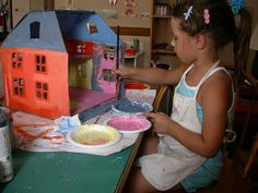 cardboard dollhouse she made with one of her daughters when she was five