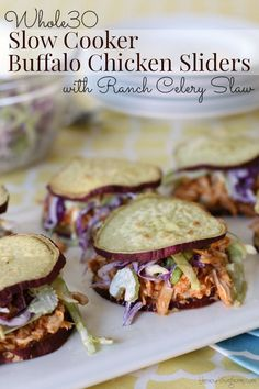 Buffalo Chicken Sliders – moist, slow-cooked chicken smothered in a spicy, flavorful sauce piled onto tasty sSweet potato buns with crunchy slaw. Slow Cooked Chicken, Slow Cooked Meals, How To Cook Chicken, Slow Cooker Recipes, Paleo Recipes, Real Food Recipes, Dinner Recipes, Crockpot Meals, Clean Recipes